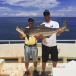 two men on charter fishing