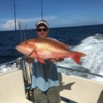 man holding giant fish florida charter